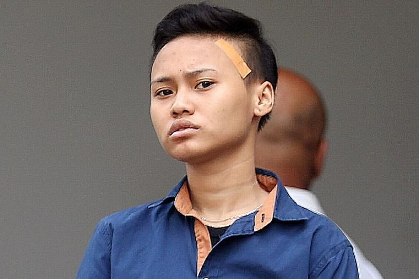 Nur Qairulnisha Rosmani, one of the three accused of buying items with counterfeit $100 notes to obtain change in real currencies.