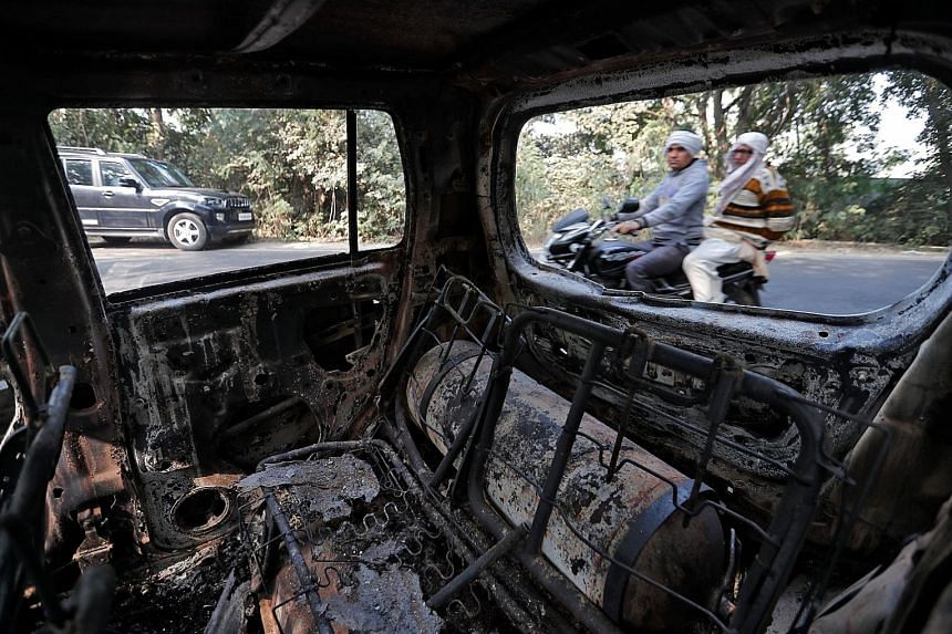 A charred vehicle that was set on fire by a mob during a protest in Bulandshahr district in India's Uttar Pradesh this month. The strong rejection of the ruling Bharatiya Janata Party has been interpreted as an indication that existential issues, suc