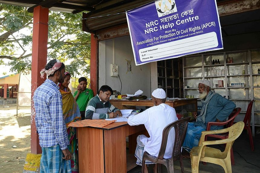 Villagers in India's Assam checking their documents earlier this month at a National Register of Citizens help centre for those whose names were not in the final draft of the register. Those not on the list could now face being stripped of their Indi