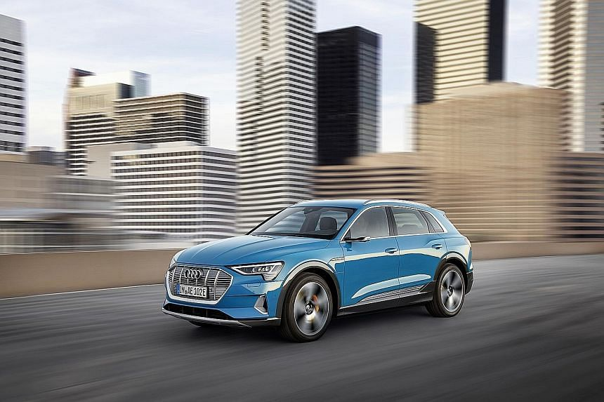 The Audi e-tron has some bespoke exterior features, such as a semi-blanked grille, pronounced fender bulges and wide rocker panel profiles along its flanks.