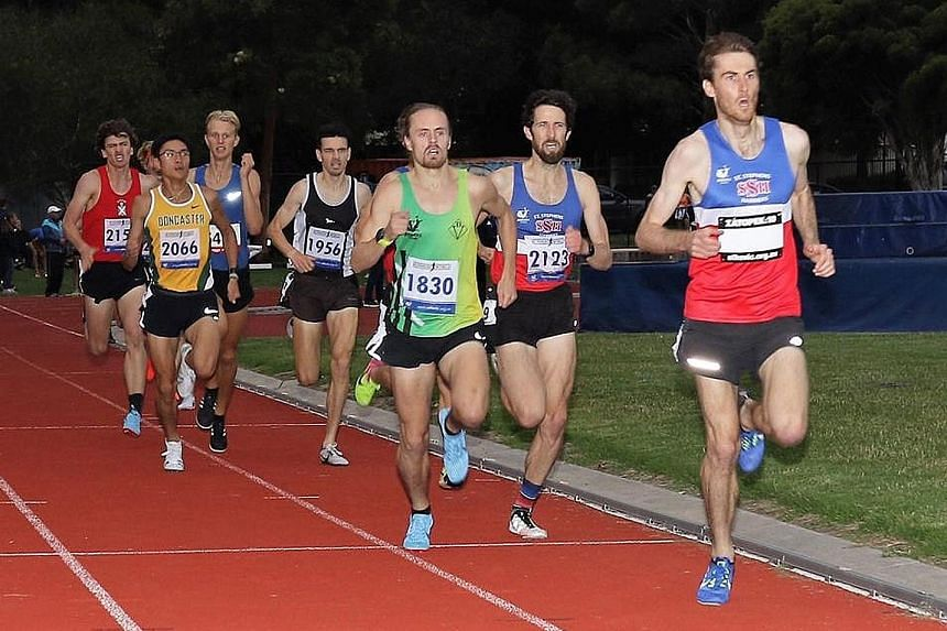 Lui Yuan Chow (in yellow), a first-year student at Melbourne's La Trobe University, on his way to breaking the national record during the Vic Milers meet in Melbourne on Thursday. He finished sixth.