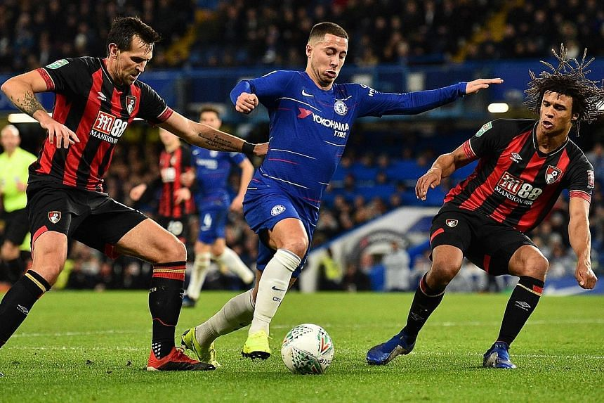 Chelsea midfielder Eden Hazard taking on Bournemouth defender Nathan Ake (right) and midfielder Charlie Daniels in their English League Cup quarter-final on Wednesday. The Belgian netted the only goal of the encounter at Stamford Bridge.