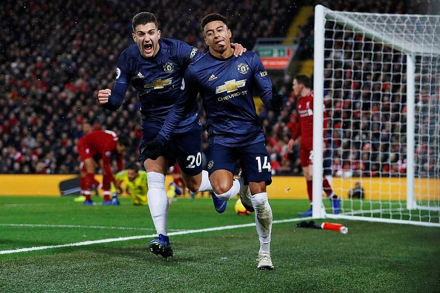 Manchester United's Jesse Lingard celebrating with Diogo Dalot after scoring in the 3-1 loss to Liverpool on Sunday. New Red Devils caretaker manager Ole Gunnar Solskjaer has been quick to preach an attacking mantra.