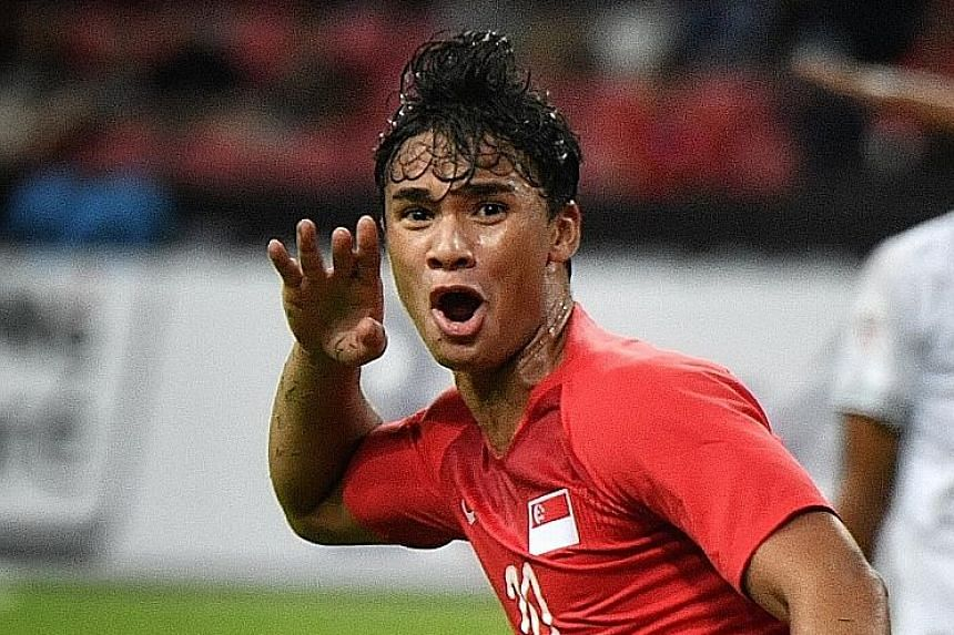Lions forward Ikhsan Fandi celebrating after his brilliant bicycle-kick goal against Timor-Leste in the AFF Suzuki Cup Group B match on Nov 21.