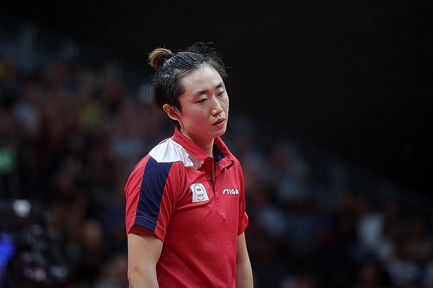 Singapore's top women's paddler Feng Tianwei looking dejected in one of her matches at April's Commonwealth Games, where she failed to retain the singles title she won in 2014.