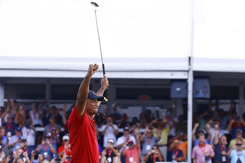 Former world No. 1 Tiger Woods raises his arms in triumph after winning the Tour Championship in September - his first PGA Tour victory in 1,876 days.