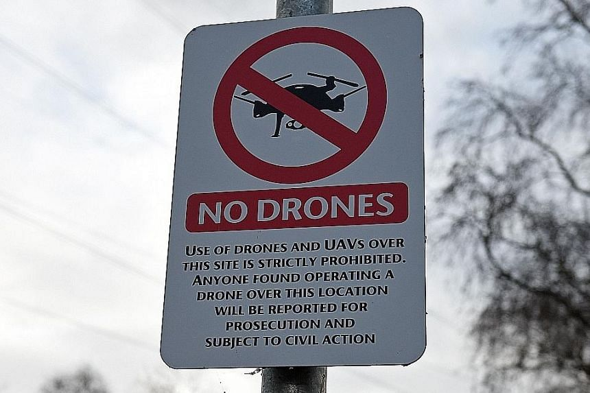A sign saying use of drones or unmanned aerial vehicles is prohibited, near English football club Manchester United's training complex in Manchester.