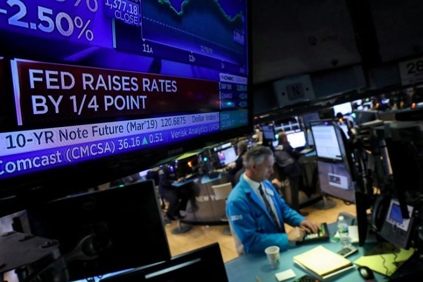 A trader works on the floor of the New York Stock Exchange in New York, US, on Dec 19, 2018.