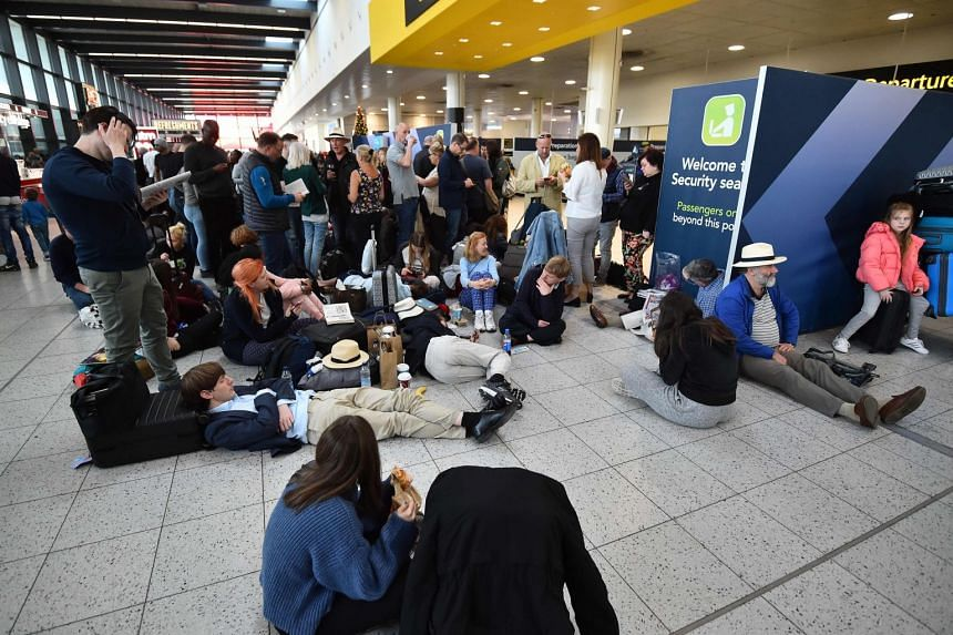 Passengers wait at the North Terminal at London Gatwick Airport, south of London, on Dec 20, 2018, after all flights were grounded due to drones flying over the airfield.