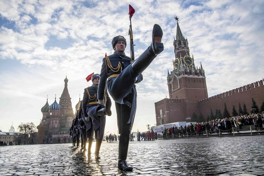 Russian honour guards march during a military parade in Red Square in Moscow in November 2018.