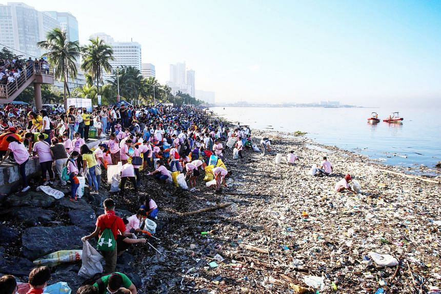 Volunteers picking up garbage at Manila Bay in September. A week-long clean-up yielded more than 54,200 pieces of plastic waste, as well as nappies, sanitary napkins and glass.