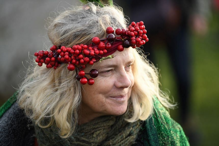 A reveller takes part in the winter solstice celebrations at Stonehenge.