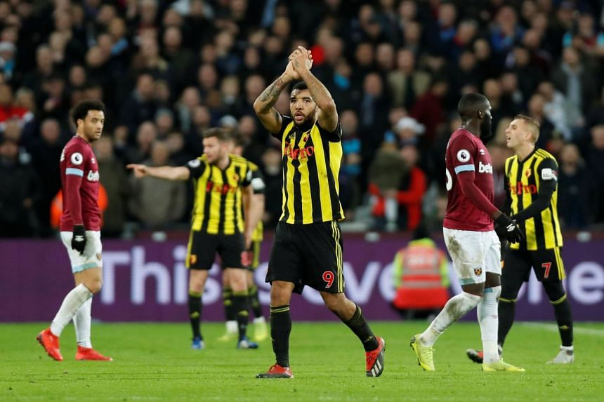 Watford's Troy Deeney applauds the fans as he is substituted off.