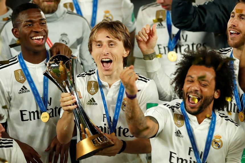 Real Madrid players celebrate with the trophy after winning the Club World Cup.