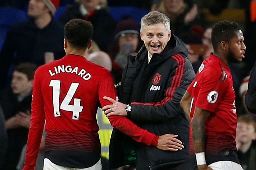 Manchester United interim manager Ole Gunnar Solskjaer celebrates after the match with Jesse Lingard.