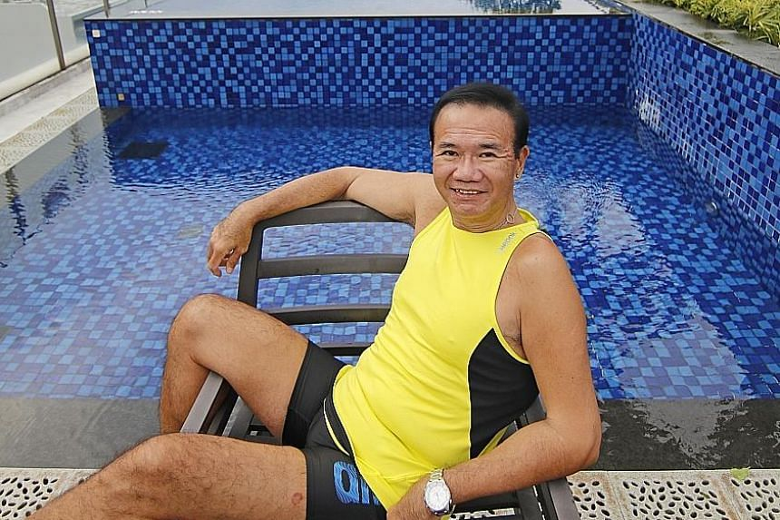 Mr Leong at the swimming pool on the estate grounds of his apartment. The estate is near an MRT station and is freehold.