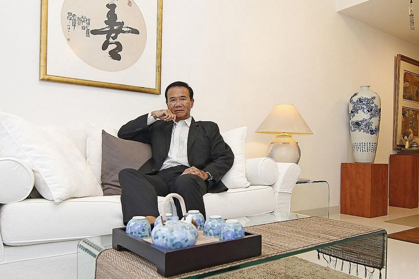 Engineer Dennis Leong in his two-bedroom apartment in the north of Singapore. He bought it last year for $800,000. He also owns a two-bedroom apartment in central Singapore, and three properties in China. All his four investment properties are fully paid
