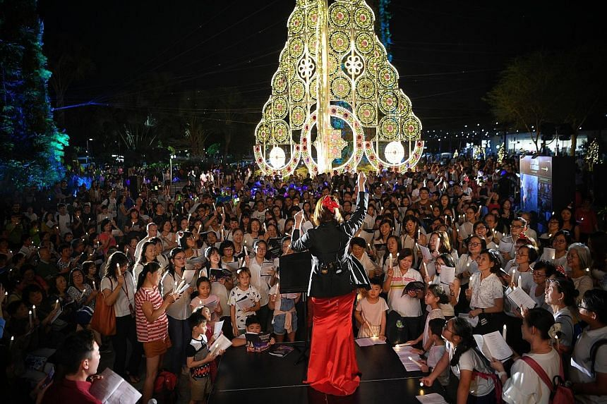 Hark, the record-breaking carollers sing. Led by music conductor Fran Ho (centre), 766 carollers at Gardens by the Bay set a new record for Singapore's largest street carolling last Friday night. They sang more than 10 songs, including Joy To The Wor