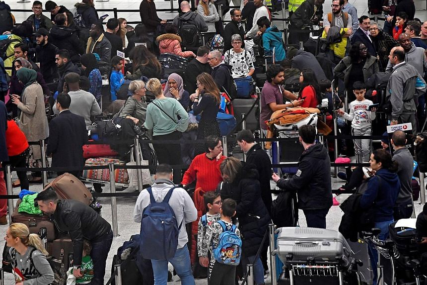 Passengers waiting to check in for their flights at Gatwick Airport last Friday, after the airport reopened, following its forced closure because of drone activity.