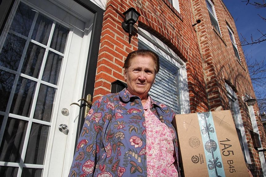 """Baltimore resident Rosemarie Dumhart, 79, uses a decoy package, marked with an X, to discourage the so-called """"porch pirates"""" operating in the Canton area of Baltimore, Maryland."""