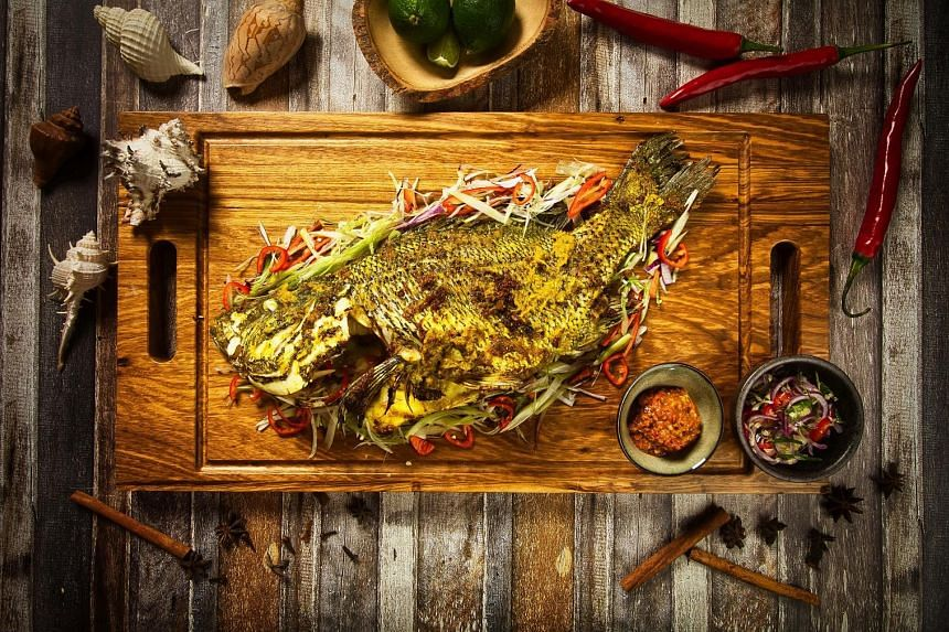 """From left: Vendace Roe From Kalix from restaurant Zen; Oven Roasted """"Forty Garlic"""" Chicken from restaurant Atout; and Grilled Whole Fish from Fat Chap."""