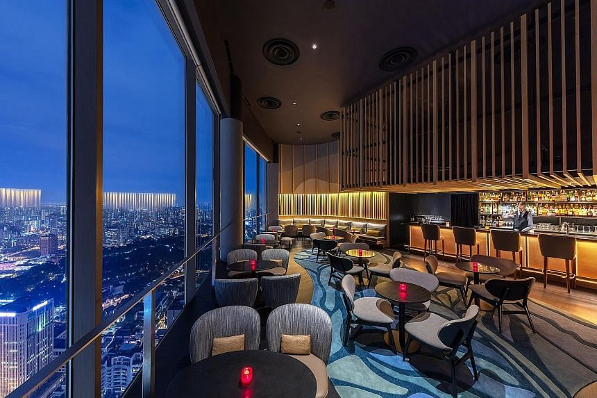 Skai Bar (above) at Swissotel The Stamford, Manhattan bar (left) at Regent Singapore and Brass Lion Distillery (right) in Pasir Panjang stand out in the Singapore bar scene.