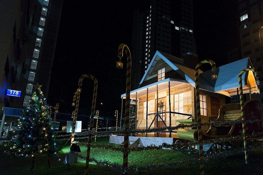 The 4.5m-tall snow-capped log cabin (left) in Woodlands is the creation of Mr Tan Koon Tat (above), who used materials sourced from lumber yards, as well as fibre fillings to create the snow effect. The 58-year-old carpenter also puts up festive deco