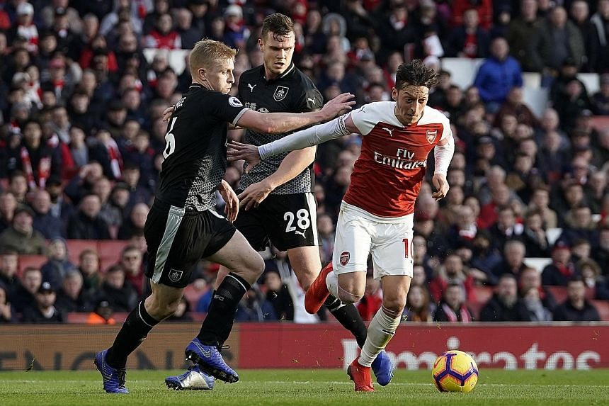 Arsenal's Mesut Ozil was frequently buffeted by a physical Burnley team yesterday. But he produced two moments of brilliance to set up his side's first and third goals as the Gunners rallied from two straight losses.