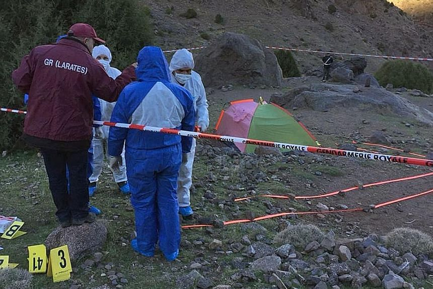 Ms Maren Ueland from Norway (far left) and Ms Louisa Vesterager Jespersen from Denmark were trekking in Morocco when they were murdered. Investigators (below) near the tent where the bodies of the women were found last Monday. Moroccan investigators