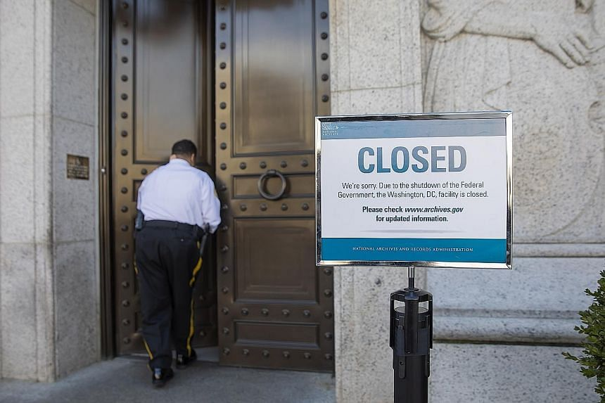 The closed National Archives building in Washington, DC, yesterday. Standard and Poor's estimates that the shutdown could shave US$1.2 billion (S$1.65 billion) off the gross domestic product each week the government is closed.
