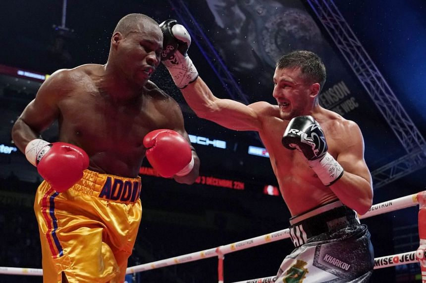 Adonis Stevenson (in gold shorts) getting hit by Oleksandr Gvosdyk in Quebec City during their WBC light heavyweight championship fight on Dec 1, 2018.