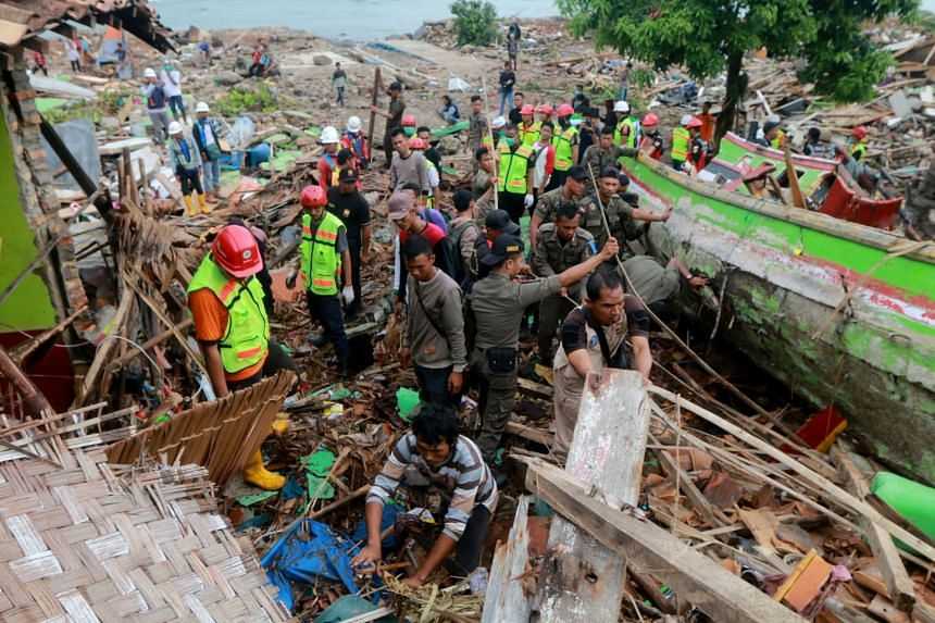 Rescuers looking for survivors along the coast in South Lampung in South Sumatra on Dec 23, 2018, after a tsunami hit the area the day before.
