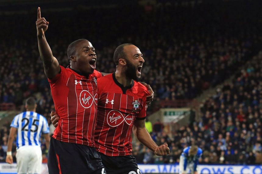 Michael Obafemi (left) celebrates with Nathan Redmond after scoring their third goal.