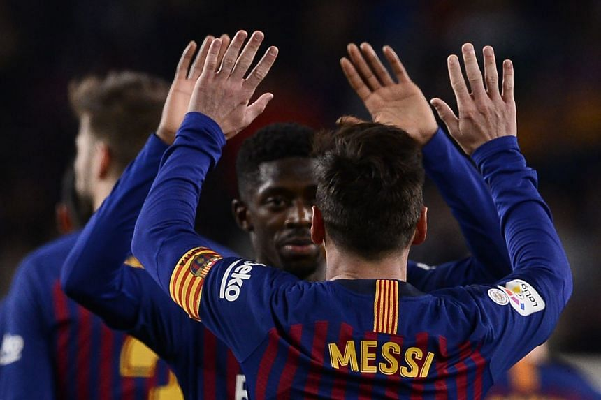 Lionel Messi celebrates a goal with Ousmane Dembele.