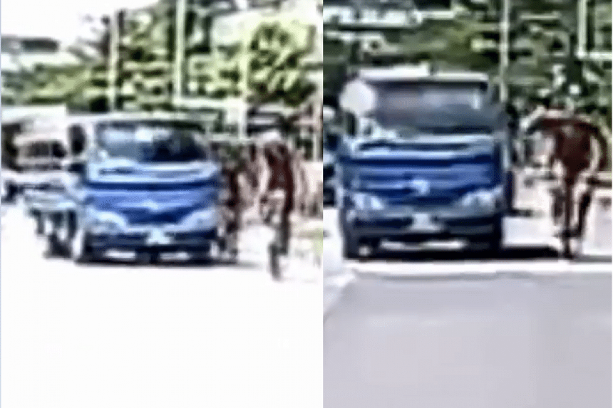 The cyclist was seen hitting the side mirror of the lorry before he was knocked over on Saturday (Dec 22). PHOTO: SCREENGRAB FROM ROADS.SG