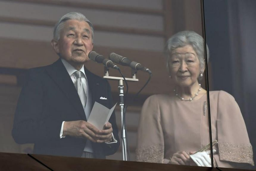 Japan's Emperor Akihito delivers a speech while greeting well-wishers on his birthday, as Empress Michiko stands beside him at the Imperial Palace, on Dec 23, 2018.