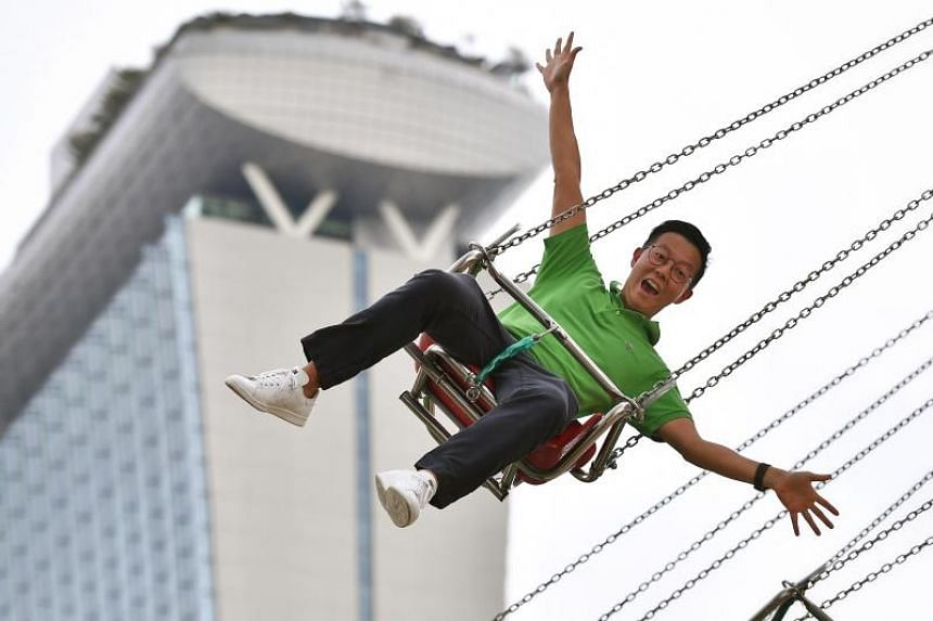 Mr Barnabas Chia, 37, general manager of Pico Pro, rides on the Wave Swinger at the Prudential Marina Bay Carnival on Dec 22, 2018.