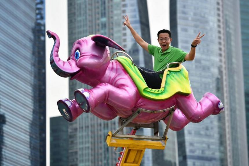 Mr Barnabas Chia, 37, general manager of Pico Pro, rides on the Dumbo at the Prudential Marina Bay Carnival on Dec 22, 2018.