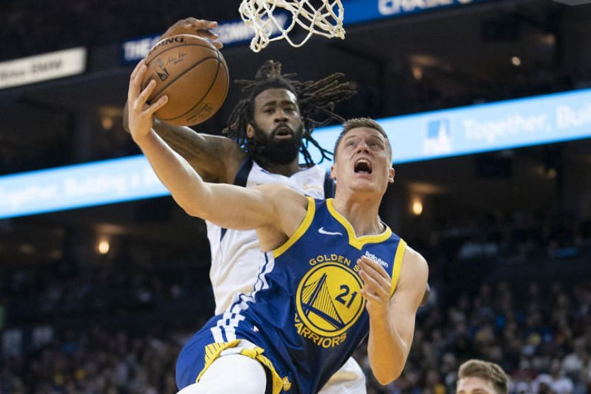 Golden State Warriors forward Jonas Jerebko (front) shoots the basketball against Dallas Mavericks center DeAndre Jordan at the Oracle Arena in Oakland, US, on Dec 22, 2018.