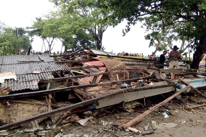 Residents inspect the damage to their homes on Carita beach on Dec 23, 2018.