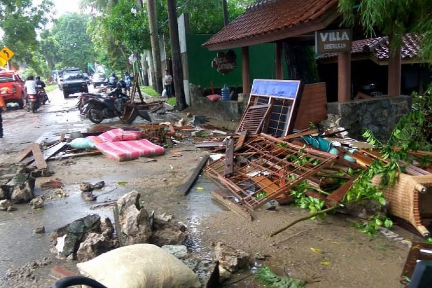 Debris from damaged buildings on a street on Carita beach on Dec 23, 2018.