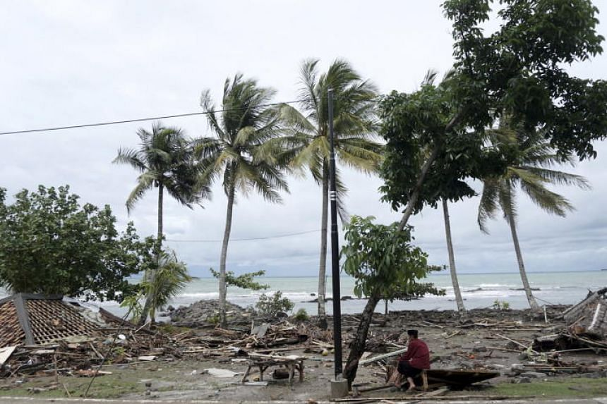 A man sits down among the ruins of houses after a tsunami hit Sunda Strait in Anyer, Banten, Indonesia, on Dec 23, 2018.