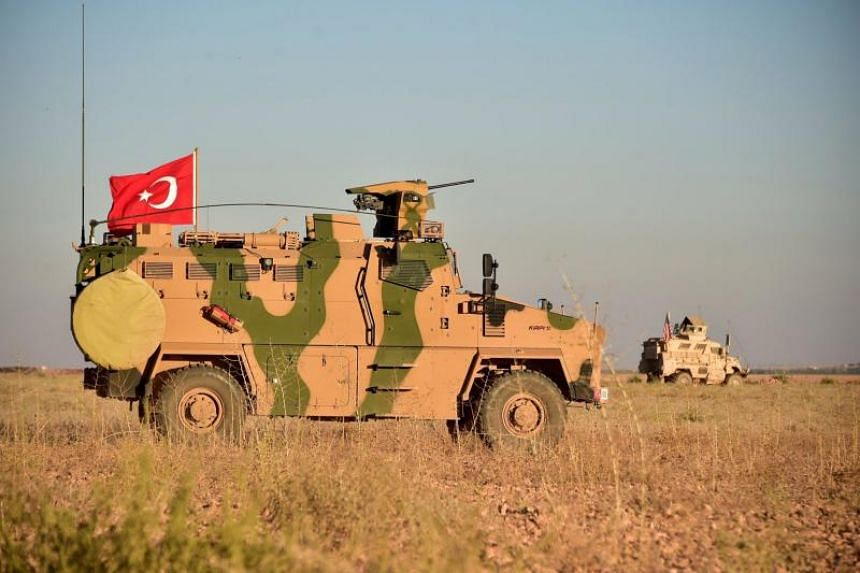 A Turkish armoured vehicle on a joint patrol with US forces near the Syrian city of Manbij on Nov 1, 2018. Turkey has sent a convoy of 200 vehicles to reinforce their presence near the city on Dec 23, 2018.