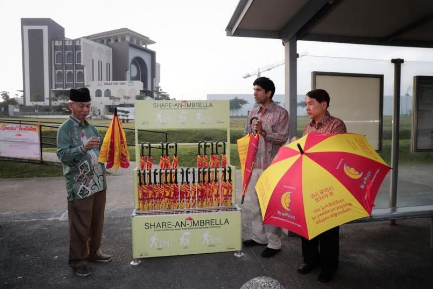 (From left) Chairman of Masjid Yusof Ishak Mr Mohammad Ayub Johari, MP for Sembawang GRC Mr Vikram Nair, and chairman of Admiralty CCC Mr Sim Kin Chye at the launch of the share-an-umbrella campaign on Dec 23, 2018.