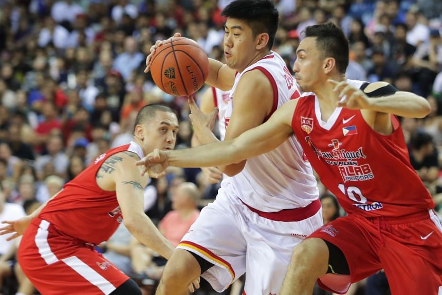 Singapore Slingers' Delvin Goh finding a way through during their home loss to the Alab Pilipinas last season. He had six points in their 77-71 defeat on Dec 23, 2018, which meant they ended the year with a two-match losing run.