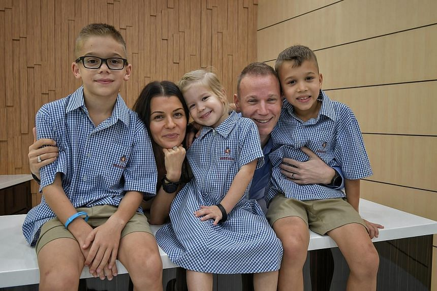 Mr Gergely Varadi and his wife Mariann, 33, with their children (from left) Leo, eight; Bella, four; and Bruno, seven. The children attend Middleton International School in Tampines.
