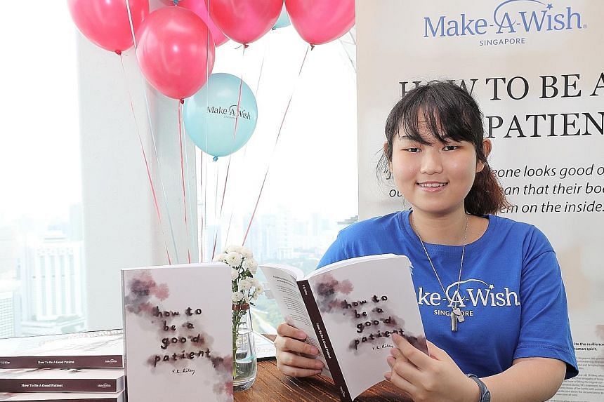 Nicole Lim with her book, How To Be A Good Patient, which covers how she found out she had three diseases at the age of 13, went through a liver transplant and found out this year that she also had osteoporosis.