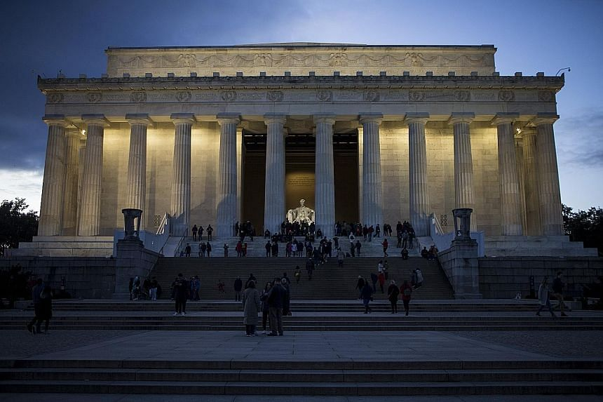 Visitors to the Lincoln Memorial in Washington on Saturday. A partial US government shutdown is set to drag through the Christmas holiday after an impasse over President Donald Trump's demand for more funds for a border wall. The political turmoil ad