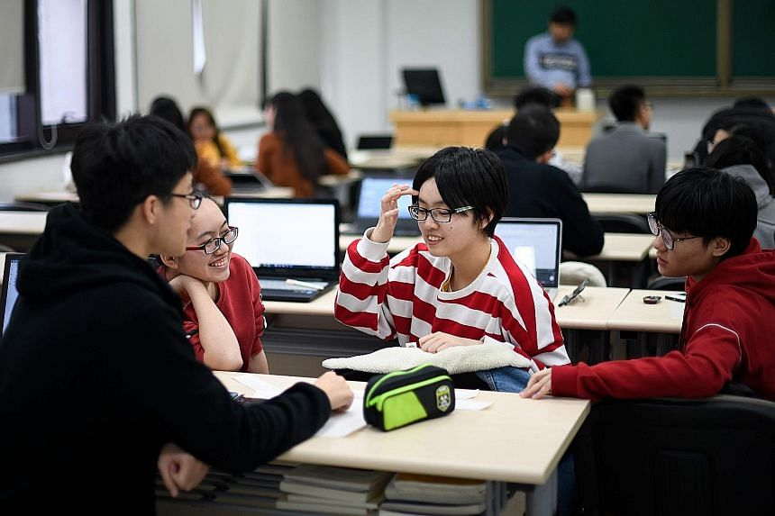Students at the business school at Beijing's elite Renmin, which claims to be the first Chinese university to offer an MBA.