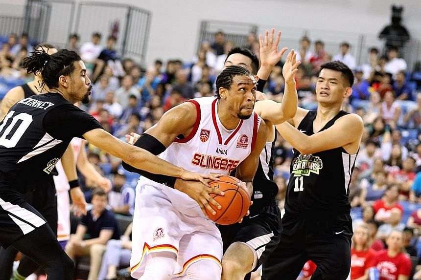 Singapore Slingers centre John Fields, seen here in action against the Macau Black Bears on Nov 30, led all scorers with 35 points in the Asean Basketball League game against the Alab Pilipinas last night. But his teammates' lacklustre shooting prove